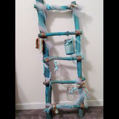 Here's something a little different to do with Shabby Paints: Painted driftwood ladder! I made this little ladder out of scrap branches and used Shabby Paints Peacock with a very wet brush to give it a wash of color.  So much fun to do!