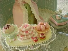 Marie Antionette- little cakes (no macs- they actually didn't exist is MA's time, ha!)