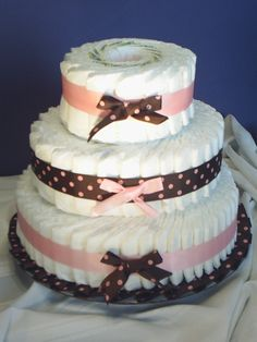 2 Diaper Cake Suggestions (I usually add a stuffed animal on top and put a teething toy through the bottom ribbon, at the least.
