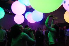 """""""teamLabBall"""" is an interactive interface that changes color and brightness and emits different sounds depending on the actions of the people around it. When you touch the spheres, it causes effects such as a change in color, or the generation of a sound. Each sphere is synchronized by wireless P2P (Peer to Peer), so it is possible to change the colors of all of the spheres or to change the color of the lighting of the space. Furthermore, it is possible for directors/designers..."""