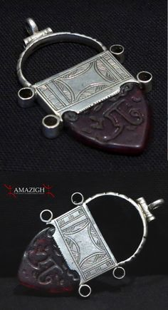 Africa | In Gall 'cross' from the Tuareg people of Niger | Silver, red glass.  Koranic inscriptions |