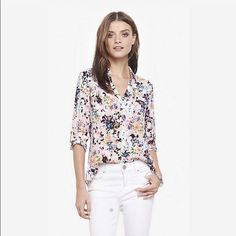Express flowery blouse Express blouse very pretty flower detail. Optional roll up sleeve buttons. Super cute, worn once. In perfect condition. SALE- Price FIRM unless you bundle. Express Tops Blouses
