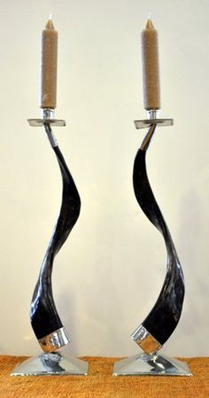 How stylish are these!  Horn and silver candlesticks @disenobos