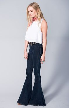 The highest ranked pull on super flares are here and ready to set you ahead of the curve.  Suck you in in all the right places with the perfect amount of stretch so you always feel free.   FINALLY you have a pair of high waisted jeans to wear your collection of Mumu crop tops with, as well as everything else in your closet.    Update!  Pant leg hem is now frayed!  Cut them yourself to any length you please!!  These bells run true to size.  *MADE IN THE GORGE USA* *No pockets in front, 2…