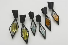 Cage earrings in oxidized silver with lemon quartz, aquamarines, and citrines.
