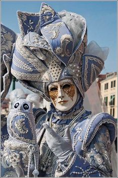 Blue Masquerade Outfit with decorative matching owl. Perhaps something from Carnivale.