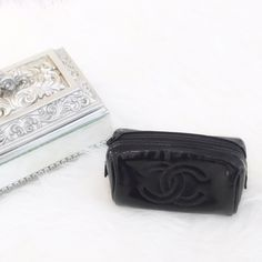 Black Chanel Coin Pouch/Purse 100% authentic Chanel pouch great for storing coins or small accessories! Selling because I never use it. There are small scratches and the item itself feels a bit sticky, but overall great condition! NO TRADES OR PAYPAL. I negotiate through the Make An Offer button. CHANEL Bags