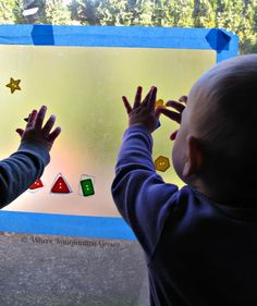 Sticky Window Baby Games-be very mindful of the size of what you are giving children to do this(still oral) but nice at their height and things to experiment with