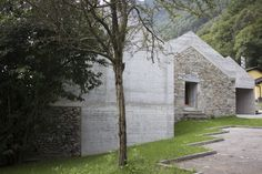 Situated on a rural plot in Switzerland, Ca' dal Mantova brings the land's ancient ruins into the century. The residence is comprised of an. Cement Walls, Concrete Wall, Aluminum Element, Stone Masonry, Ancient Buildings, Reinforced Concrete, Perfect Cup, Ancient Ruins, House Extensions