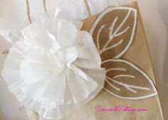 Coffee Filter Gift Wrap is an easy and inexpensive way to make your packages look beautiful