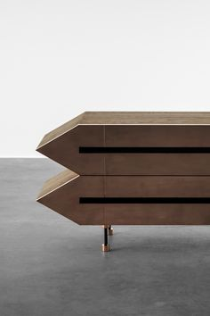 Furio sideboard - retro futuristic media cabinet inspired by brutalist furniture design - here shown in a combination of solid oak wood and copper metal finish.