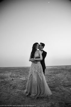 Pre Wedding Shoot - Shoot Set in a Desert with the Groom in a Black Tuxedo and Bride in White Gown | WedMeGood #prewedding #ideas #shoot #wedmegood #realcouple #indianbride #indianwedding #preweddingphotoshoot