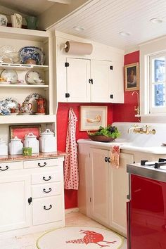 "I Do like the thought of red walls in the red and white kitchen.  That has ""Me"" written all over it!"