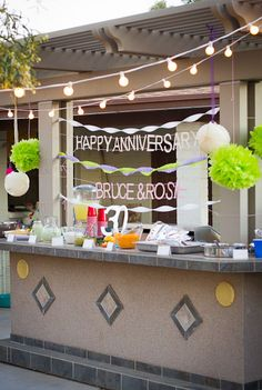 Tropical feel surprise anniversary party with ruffled crepe paper and Sweet Pork Salad.