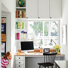 Adjacent to the kitchen, a built-in office nook looks out onto the backyard, keeping the kids under their mother's close watch. At left, an inset steel panel provides a place to show off artwork.