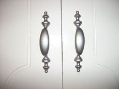 Refinished kitchen cabinet handles and hinges.  They were antique gold.  Used satin nickel spray paint.