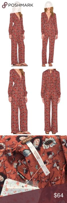 👗🐻❤️️Free People Some like it hot jumpsuit ♥️ NWT Gorgeous Some Like It Hot Jumpsuit by Free People long sleeve subtly flare in beautiful rust color so comfy and lovely on♥️ Free People Pants Jumpsuits & Rompers