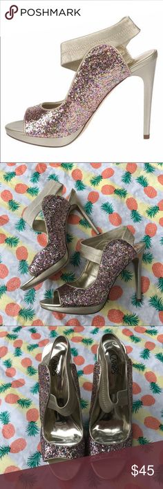 Colorful Glitter Slip On Stiletto Heels Lightly Used | Excellent Condition | Multi Color Glitter | Gold Strap & Heel | Slip On | Stiletto Heel | Sign of Wear on Inside & Bottom | From the Halo Collection | Size: 8.5M = Medium | Man Made Materials | Carlos Santana Shoes Heels
