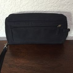 Simple Black Wallet/Wristlet Great wallet with 24 slots for credit cards!!  Lots of great compartments. Used, but good condition. Bags Clutches & Wristlets