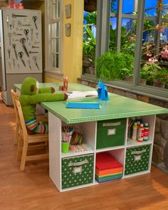 writing center - 2 shelves and a piece of wood = large scale kids table with plenty of storage.