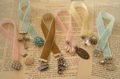 "Vintage Bookmarks using 9"" strips of velvet ribbon, ribbon clamps on both ends, & jewelry or beads attached with jump rings. How awesome to make these during Bible study."
