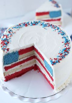 A classic Red, White and Blue layered flag cake with a fluffy vanilla cake base and a whipped vanilla buttercream.