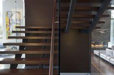 Dark wood floating staircase.