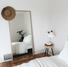 adorable bedroom // neutral color palette, contemporary, interior design inspiration, modern living, simple, simplistic, greys, grays, inviting, diy, casual style, home, house, room, classy, chic, inviting, white, clean aesthetic, girly, fresh, plants, green living, white on white, all white everything, large mirror, nightstand, white bedspread, bedroom plants