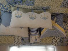 Pillows made using pieces of old pillowcases and vintage hankies.