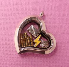 Weve filled this sweet heart design locket full of charms that weve collected that make us think of the Harry Potter Series. Your Hogwarts