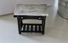 Cinderella Moments: Some Dollhouse Furniture, tabletop with tin foil and black paint.