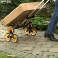 The UpCart is a trolley/cart that helps you haul large objects up and down stairs. The trolley is made up of 3 wheels that rotate when they hit a stair. On flat ground, the cart rides on two wheels wi. Creative Birthday Ideas, Birthday Ideas For Her, Hand Cart, Stair Climbing, Trolley Cart, Moving Furniture, Cool Gadgets To Buy, Home Gadgets, Cool Inventions