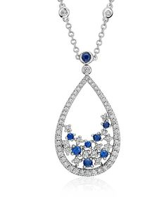Grace your look with the elegance of this sapphire and diamond floral teardrop necklace, framed in 18k white gold.
