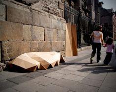 fernando resendiz folds cardboard into a homeless shelter