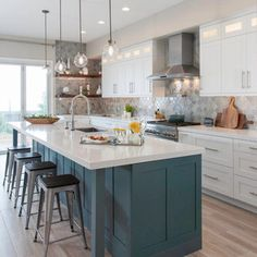 Love the beautiful look of this kitchen. The subtle color of the flooring is perfect in contrast to the uniquely teal kitchen island and white cabinetry. Blue Green Kitchen, Green Kitchen Island, New Kitchen, Kitchen Ideas, Kitchen Trends, Kitchen Inspiration, Colorful Kitchen Decor, Kitchen Colors, Teal Kitchen Designs