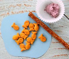 "Dip pretzel rod in peanut butter or cream cheese and let kids ""fish!""  So fun!"