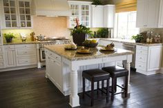 Large white kitchen with great lighting built into the cabinetry.