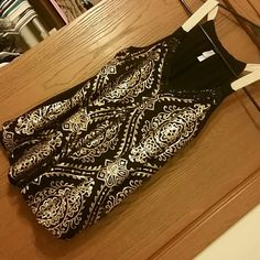 Gold sequin Tank top Black tank top with cute gold sequin detail on front. Never worn. Cute for day time or a night out. NWOT. Xhilaration Tops Tank Tops