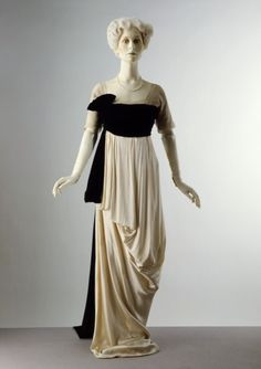 Evening Dress Made Of Satin Trimmed With Chiffon And Machine-Made Lace, Silk Velvet, Lined With Grosgrain And Whalebone. Made By Lucile - London, England c. 1912 The Victoria & Albert Museum