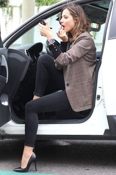 I love this photo of a slim legged women in skinny jeans and pumps putting on her game face.