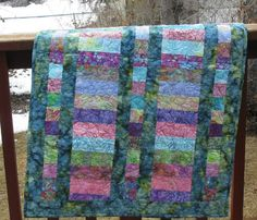 of course I love this... It has my kind of fabric!   Quilted Baby Crib Quilt with Hoffman Batiks by Mountainquiltworks, $75.00