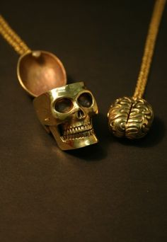 Skull necklace with removable brain.