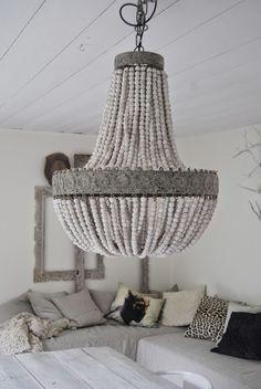 wood beads chamdelier with intricate metal trim #casatreschic #kouboo