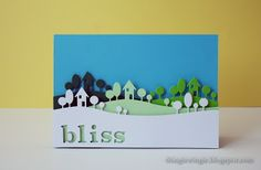 "handcrafted greeting card from ""little things"" blog ... layers of progressively darker Memory Box  landscape die cuts popped up ... luv the illusion of great depth ...negative die cut ""bliss"" in the top layer ... delightful scene ..."