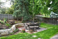 sloped backyard: mine is way more sloped, but i like the short wall. I would put something on top of it to make it a bench