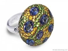 A magnetic meadow of gems and diamonds unite in this 18-karat white gold dazzler