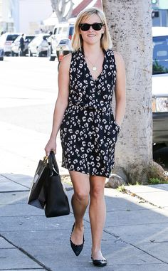 It must not be cold in Cali because Reese Witherspoon showed some skin in an adorable summery dress paired with classic wayfarer sunnies!