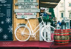BUDAPEST HUNGARY - DECEMBER 28: Decorative bicycle on stand at Christmas market near Saint... by 2enroute
