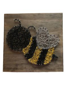 Bumblebee string art sign made with string and nails. Decorative sign for a nursery or a child's room. This is one bee that won't sting. Board measures 7 1/4 x 7 1/4. Size may vary slightly. Walnut stain is used on the board. If you want to use a different colored string or a different