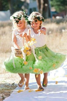 Flower girls in simple tank tops and tutus. very adorable